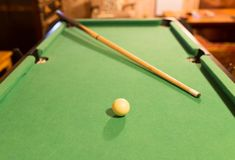 Board game with balls and cue billiards.  Stock Image