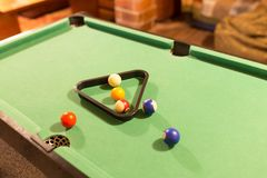Board game with balls and cue billiards.  Royalty Free Stock Image