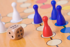 Board game with color pawns stock photography