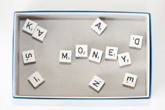 Board game dice spelling out. \\\money\\\ in game box Stock Photography