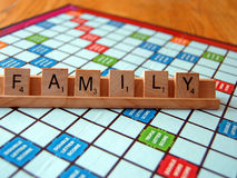 Board Game Family. The game scrabble with the word family in letter pieces Stock Photos