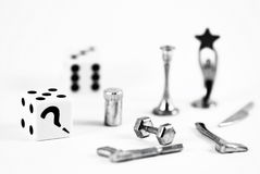 Board game figures. Two dice with staindless steel pieces Royalty Free Stock Photography