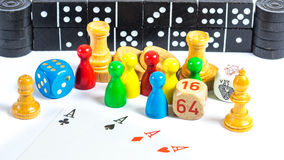 Board game figures. Many board game figures in front of white background Royalty Free Stock Photo