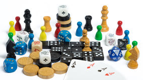 Board game figures. Many board game figures in front of white background Stock Photography