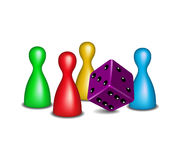 Board game figures with purple dice Stock Photography