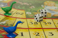 Board game. With geese and cubes Stock Photos