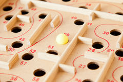 Board game. Board labyrinth game, focus on a ball stock photo