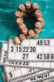 Board game lotto. Traditional legacy of the ancient Board game Lotto on wooden background Royalty Free Stock Photography