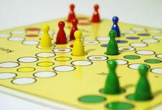 Board game, ludo. Board game with colorful game pieces Royalty Free Stock Image