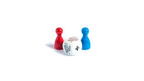 Board game pieces and a dice. In front of white backgroundn Stock Photos