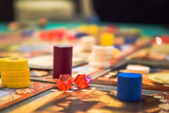 Board game. Scene with tokens and jewels on a table stock images