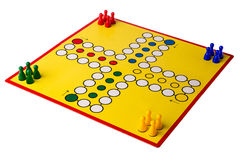 Board game. Yellow board game with four different colored game pawns on it Stock Photos