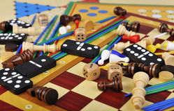 Board games. Various board games and many figurines background Royalty Free Stock Photography