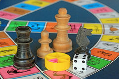 Board games, chess pieces and dice on game board with lot of colors. Board games. Close up of game board with chess pieces and dice. Board with lot of colors Stock Image