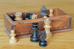 Board games, chess pieces on table and box Stock Photos