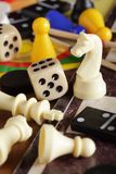 Board games. Detail of board games, pawns, chessmen, dominoes and dices royalty free stock images