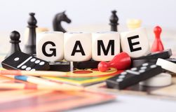 Board games. Detail of board games, pawns, chessmen, dominoes, mikado sticks Stock Photos