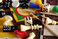 Board games. Detail of board games, pawns, chessmen, dominoes, mikado sticks and dices royalty free stock photos