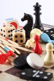 Board games. Detail of board games, pawns, chessmen, mikado and dices Stock Photos