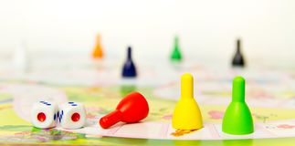 Board games for the home. Colored plastic chips and dice on the background of board games . Selective focus