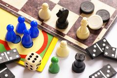 Board games. Pawns, chessmen, dominoes and dice Royalty Free Stock Photos