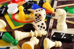 Board games. Pawns, chessmen, dominoes and dices Royalty Free Stock Images