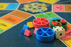Board games, pieces and dice on game board with lot of colors. Board games. Close up of game board with pieces and dice. Board with lot of colors royalty free stock photos