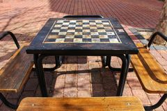 Board games on the street on wooden table. And chairs Royalty Free Stock Photo