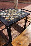 Board games on the street on wooden table. And chairs Royalty Free Stock Image