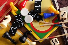 Board games. Top view of board games, pawns, chessmen, dominoes, mikado sticks and dices Royalty Free Stock Image