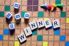 Board games. The winner of the game. game cubes and chips on the canvas.  Stock Photos