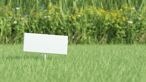 Board on grass field Stock Photos