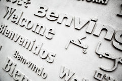 Board with greetings. In different languages close up Stock Photo