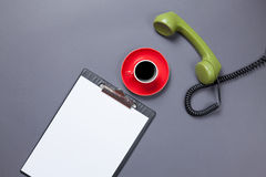 Board and handset with coffee Royalty Free Stock Photo