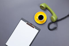 Board and handset with coffee Stock Photos