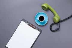 Board and handset with coffee Stock Photo