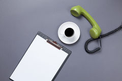 Board and handset with coffee Stock Images