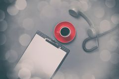 Board and handset with coffee Royalty Free Stock Image