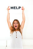 Board HELP. NEED HELP? portrait young woman with board HELP Royalty Free Stock Images