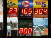 Board with high jack pots. Lottery sign with 800 Million Power Ball and 165 Million Mega Million jack pots in NJ. 2016, USA. Г. Stock Image