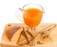 Board with jug of kvass, bread and ears on white. Royalty Free Stock Photography