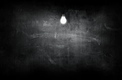 Board lit by bulb Stock Image