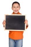 Board. Little boy holding a black board Royalty Free Stock Image