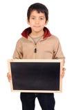 Board. Little boy holding a blackboard Stock Image