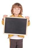 Board. Little boy holding a blackboard Royalty Free Stock Photos