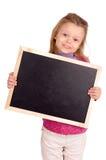 Board. Little girl holding a blackboard Stock Photo