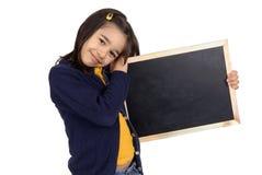 Board. Little girl holding a blackboard Stock Photography