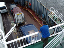 On Board. Male is on the deck of the ferry stock photography