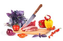 Board with meat and vegetables isolated. On white background Stock Photos