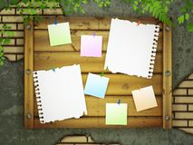 Board for messages at grunge wall Stock Images